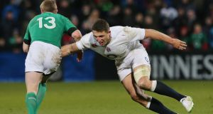 Ireland Wolfhounds' Keith Earls is tackled by England Saxons' Sam Burgess during the match at Musgrave Park in Cork. Photograph: Getty Images
