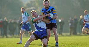 UCD's Jack McCaffrey in action against Kieran Martin of Athlone IT at Belfield. Photograph:   Donall Farmer/Inpho
