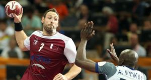 Qatar's Bertrand Roiné (left) playing against his old team-mates in World Handball Championship final meeting with France. Photograph: Karim Jaafar/AFP/Getty Images
