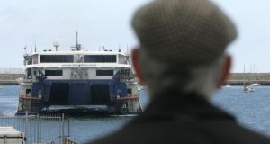 A man watching the arrival of Stena Line from Hollyhead to Dun Laoghaire. Photograph: Cyril Byrne / The Irish Times