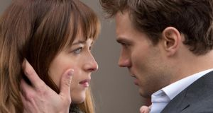 Dakota Johnson and Jamie Dornan in 'Fifty Shades of Grey' which is coming out on Valentine's Day