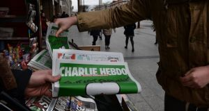"The ""survivors' edition"" of  Charlie Hebdo magazine on sale at a news stand on O'Connell Street, Dublin in January. Photograph: Dara Mac Dónaill/The Irish Times"