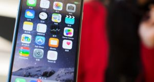 Smart move? An iPhone user was charged for Vodafone Live updates she didn't want. Photograph: Johannes Eisele/AFP/Getty