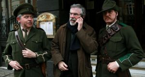 Sinn Féin leader Gerry Adams with actors Jim Roche, as Padraig Pearse (left), and Dave Swift, ahead of the launch of Sinn Féin's National Programme of Events surrounding the 1916 Commemorations, at Wynn's Hotel, Abbey St, Dublin. Photograph: PA