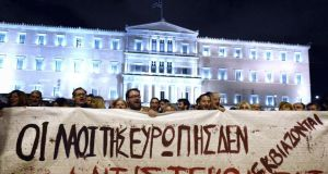 "People hold a banner reading ""people of Europe won't be blackmailed, they will resist""  in front of the greek parliament in Athens in support of the new anti-austerity government's efforts to renegotiate Greece's international loans. Photograph: AFP Photo/Getty Images"