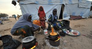 Nigerian refugee women cook in a United Nations Refugee Agency (UNHCR) refugee camp in Baga Sola by Lake Chad, which borders Chad, Nigeria, Niger and Cameroon. Since the beginning of January more than 14,000 people have fled to escape the bloody attacks by Islamist group Boko Haram. Photograph: AFP/Getty Images/Sia Kambousia Kambou