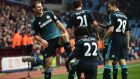 Branislav Ivanovic celebrates with his team mates after scoring Chelsea's winner in their 2-1 win over Aston Villa at Villa Park. (Photograph: Ben Stansall/AFP/Getty Images)