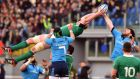 Ireland's Paul O'Connell makes a spectacular catch in the lineout ahead of Italy lock George Biagi. Photograph: Gabriel Bouys/AFP/Getty Images