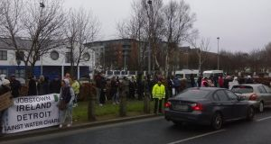 Protesters outside Tallaght Garda station on Monday.