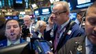 NYSE traders: Critics say cap-weighted indices run the risk of significant declines if a handful of constituent stocks tumble and that tracker funds will end up being too invested in overpriced stocks, and too little in underpriced stocks. Photograph: Brendan McDermid/Reuters