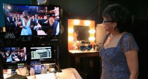 Behind the scenes: Oscars president Cheryl Boone Isaacs watches Lupita Nyong'o react to being named Best Supporting Actress backstage in 2014. Photograph: Christopher Polk/Getty