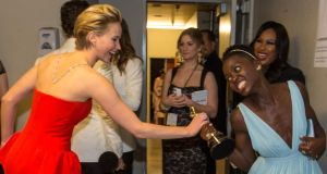 Behind the scenes: Jennifer Lawrence and Lupita Nyong'o backstage in 2014. Photograph: Christopher Polk/Getty