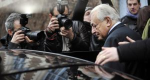 Former IMF chief Dominique Strauss-Kahn leaves his hotel in Lille to attend his trial on charges of procuring women. Photograph: AFP