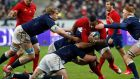 France's Mathieu Bastareaud  is tackled by Scotland players  during their Six Nations game  at the Stade de France.