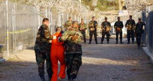 Detained: a prisoner at Guantánamo Bay. Photograph: Petty Officer 1st Class Shane T McCoy/US Navy/Getty