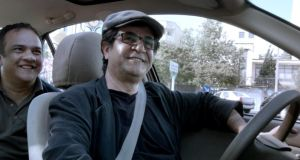 This handout film grab image released by the International film Festival Berlinale shows Iranian dissident director Jafar Panahi playing the role of a taxi driver in his film Taxi, for which he received the Golden Bear. Photograph: AFP