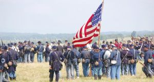 Cavalry soldiers reenacting the  American civil war Battle of 2nd Manassas at Cedar Creek Battlefield in Virginia: historians have called on the Goverment to remember the 'forgotten Irish' who fought in the war. Photograph: Thinkstock
