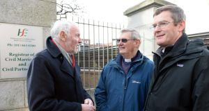 Brendan Butler, We Are Church Ireland, Archdeacon Gordon Linney, and Canon Mark Gardner, at the launch of Faith in Marriage Equality, outside the Civil Registry Office, in Dublin. Photograph: Eric Luke
