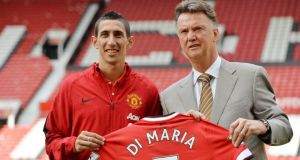 Manchester United winger Angel Di Maria (L) displays his new shirt and number on the pitch at Old Trafford with Manchester United manager Louis van Gaal. Photograph: Peter Powell/EPA