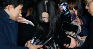 Heather Cho, daughter of chairman of Korean Air Lines Cho Yang-ho, is surrounded by the media as she leaves for a detention facility after a court ordered her to be detained, at the Seoul Western District Prosecutor's office.  Photograph: Kim Hong-Ji/Reuters