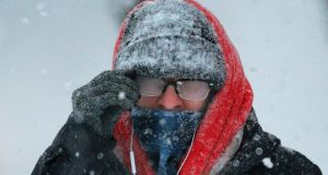 A pedestrian with his glasses fogged over walks through the snow during a winter blizzard in Cambridge, Massachusetts. Photograph: Brian Snyder/Reuters