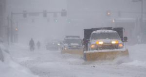 Snow ploughs  make their way down Kneeland St .during winter storm Neptune which dropped over a foot of snow  in Boston, Massachusetts.Photograph:Scott Eisen/Getty Images