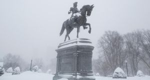 The snow covered George Washington statue in the Boston Public Garden during winter storm Neptune. Photograph: Scott Eisen/Getty Images