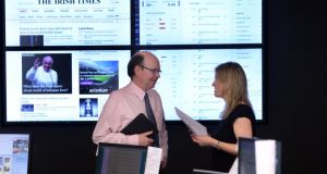 "'Irish Times' editor Kevin O'Sullivan with deputy news editor Eithne Donnellan in the newsroom. ""We believe loyal readers will be happy to pay for full access. At the same time, we will continue to offer a large amount of free content,"" O'Sullivan said. Photograph: Dara Mac Dónaill"