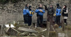French gendarmes at the desecrated Jewish cemetery of Sarre-Union in France. Photograph: Frederick Florin/AFP/Getty