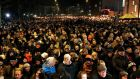 People attend a memorial service for victims of deadly attacks on a synagogue and an event promoting free speech, in Copenhagen. Photograph: Linda Kastrup/Scanpix /Reuters