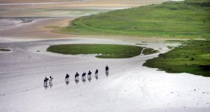 Early morning horseriders make their way across the sand flats at Derrynane Bay, Co Kerry, which took second place in Ireland's top 10 beaches. Photograph: Bryan O'Brien/The Irish Times
