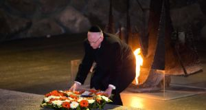 Minister for Foreign Affairs Charlie Flanagan lays a wreath during a ceremony in the Hall of Remembrance at Yad Vashem Holocaust memorial in Jerusalem.  Photograph: Ronen Zvulun/Reuters
