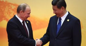 Russia's president Vladimir Putin with China's president Xi Jinping: China and Russia will mark their growing closeness with a series of high-level exchanges in coming months, including military parades and joint commemorations of the 70th anniversary of the end of the second World War. Photograph: Greg Baker/AFP/Getty