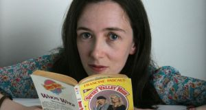 Anna Carey with a copy of one of the Sweet Valley High books, her guilty pleasure reads as a teenager. Photograph: Cyril Byrne/The Irish Times