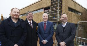 In front of UEA's new Enterprise Centre (from left) James Todd of Architype; John French, CEO of Adapt Low Carbon Group; John Desmond, managing director, Cygnum Timber Frame, and John Hunt, of Enterprise Ireland