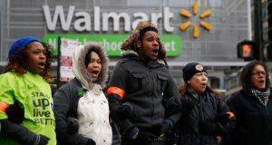 Protesters outside a Wal-Mart store late last year. Photograph: Reuters