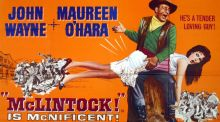 The poster for 'McLintock!' is one of dozens of vintage posters on auction and is signed by Michael Wayne, John's son