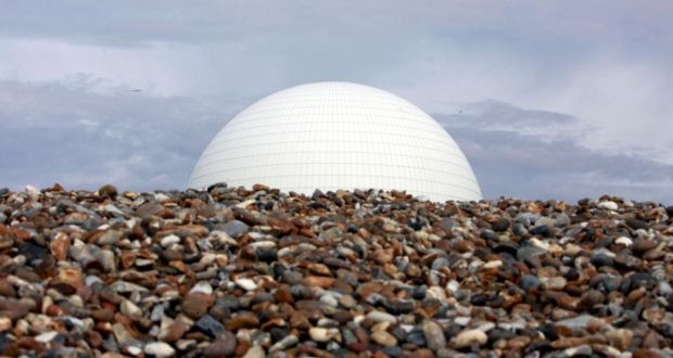 Looming danger?: a nuclear reactor dome rises over an English beach. Photograph: Jason Alden/Bloomberg