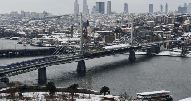 A general view shows the Golden Horn Metro Bridge in Istanbul: Turkey's largest city racks up a massive 55%  of the country's total trade production and  35 billionaires – more than Paris, Tokyo or Dubai – have made their homes there.  Photograph: Ozan Kose/AFP/Getty Images