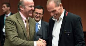 Greek finance minister Yanis Varoufakis (R) shakes hand with his Spanish counterpart  Luis De Guindos   during an extraordinary euro zone finance ministers meeting (Eurogroup) to discuss Athens'  bailout. Photograph: Eric Vidal/Reuters.