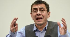 Juan Carlos Monedero,  third-in-command of Spanish anti-austerity party Podemos, during a press conference in Madrid. Mr Monedero described a controversy over payments he received from from the Venezuelan, Bolivian, Ecuadorian and Nicaraguan governments as a 'government set up'. Photograph: Javier Soriano/AFP/Getty Images