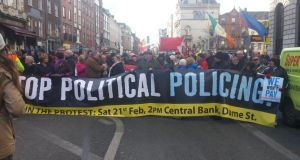 Protestors gather in central Dublin to march against 'political policing' amid rising anger over jail sentences. Photograph: Kitty Holland