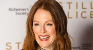 "Julianne Moore, who is tipped to win best actress for her performance as a linguistics professor with early-onset Alzheimer's disease, said the experience of Richard Glatzer and his co-director and husband Wash Westmoreland ""parallel"" the film's story. Photograph: Dominic Lipinski/PA Wire"