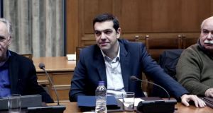 Greek Prime Minister Alexis Tsipras attends a cabinet meeting in the Greek parliament in Athens on Saturday. Photograph: Angelos Tzortzinis/AFP/Getty Images