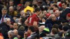 Wales' George North leaves the field to be assessed after a head injury during the Six Nations match against England at the Millennium Stadium. Photograph: Joe Giddens/PA Wire.