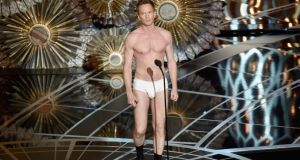 Oscars  host Neil Patrick Harris stands unclothed onstage during this year's ceremony. Harris's performance as host drew poor reviews. Photograph:  Kevin Winter/Getty Images