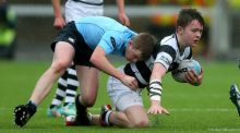 Ruadhan Byron of Belvedere is tackled by Conor Treacy of St Michael's at Donnybrook. Photograph: Donall Farmer/Inpho