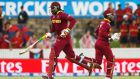 West Indies batsmen Chris Gayle (L) and Marlon Samuels score runs during their partnership against Zimbabwe during their World Cup Cricket match in Canberra. photograph: David Gray/Reuters