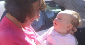 Baby love: Sharon Hutchinson meets her granddaughter Ella for the first time, at Perth Airport