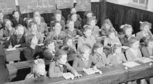 In the whole-class teaching method, the teacher stands at the blackboard, teaches the whole class the established body of knowledge, tests the children with questions and ensures a disciplined class environment. This type of teaching was the norm in Ireland until the 1960s. Above, schoolchildren in the west of Ireland in 1955. Photograph: Three Lions/Getty Images